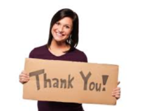 woman holding sign saying thank you Thank Donors