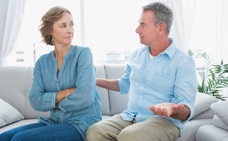 couple in a disagreement disinterested spouse