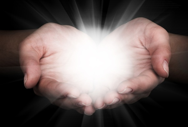 hands open with light in palms transformational gift