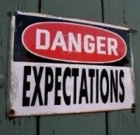 picture of a sign saying danger expectations expect