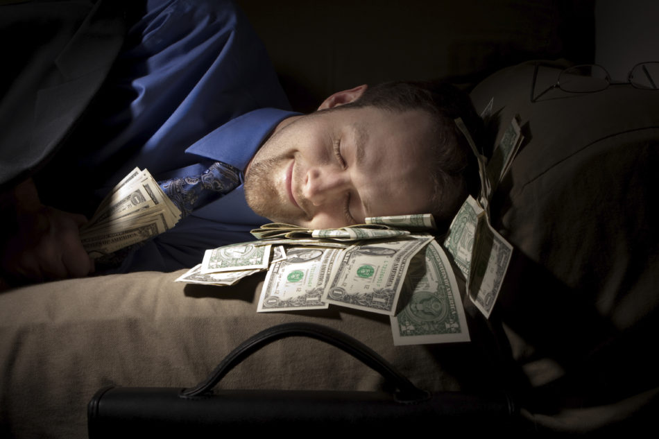 picture of man sleeping on dollar bills successful major gifts