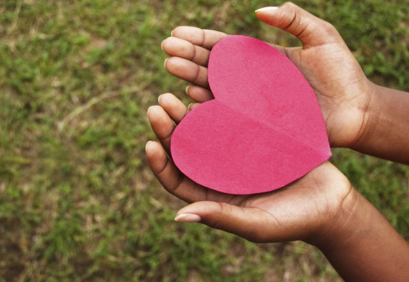 picture of a pair of hands holding a paper heart