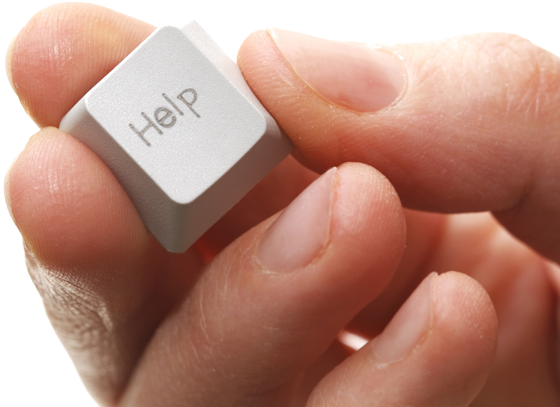 picture of a hand holding a keyboard key that says help support