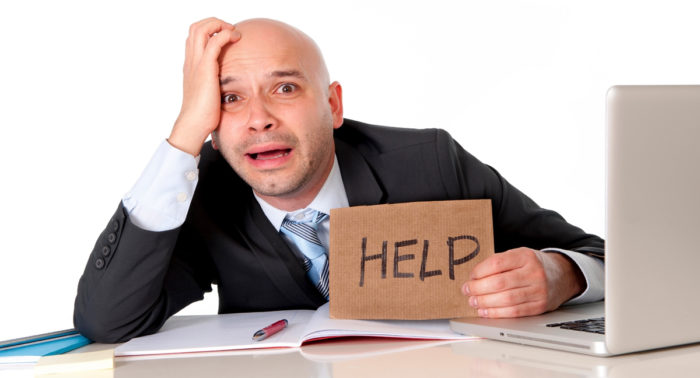 picture of a stressed out worker holding a sign saying help non-profit management