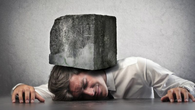 picture of a man with a rock on top of him under pressure - donors